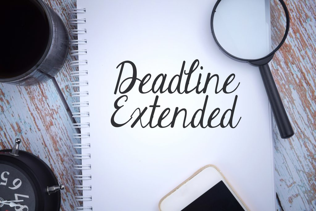Deadline Extended Image - Wording on pad with cup, phone, magnifying glass